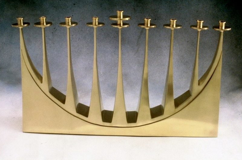 "Hanukka Menorah. 1990. Brass. 14"" x 9"" x 2"". Commissioned for Temple Sinai by M/M Howard Weinstein"