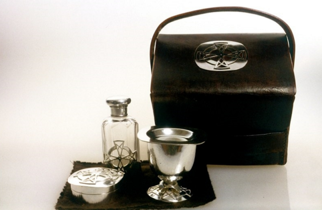 "Home Communion Set. 2005. Sterling, antique crystal bottle, leather. 5"" x 6"" x 4"". Christ Church, Anglican"